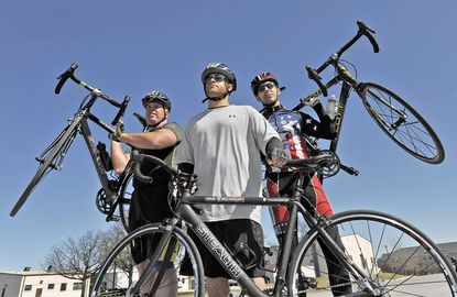 Staff Sgt. Brett Althoff, 43, Staff Sgt. Curtis Winston, 29, and Sgt. Robbie Gaupp, 26, pose after competing in the morning 30-kilometer cycling event as they try out for the Army team at Fort Meade.