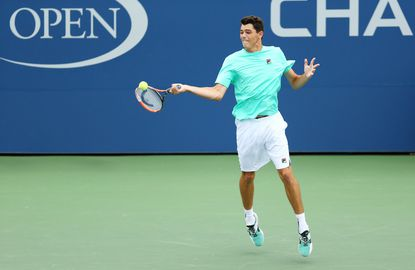 Taylor Fritz returns a shot to Tommy Paul during the 2015 U.S. Open boys' final.