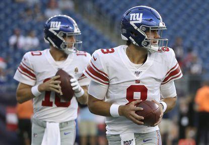 New York Giants quarterbacks Eli Manning, left, and Daniel Jones warm up before an NFL preseason football game against the New England Patriots, Thursday, Aug. 29, 2019, in Foxborough, Mass.