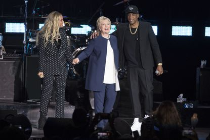 Jay Z, right, and Beyonce, left, stand with Democratic presidential candidate Hillary Clinton during a campaign rally in Cleveland, Friday, Nov. 4, 2016.