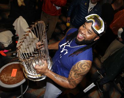 Kansas City Royals' Johnny Cueto celebrates after Game 5 of the Major League Baseball World Series against the New York Mets on Monday, Nov. 2, 2015, in New York. The Royals won, 7-2, to win the series.