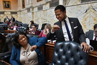Del. Chanel Branch, a Baltimore Democrat who took over the 45th District seat from Cheryl Glenn, bumps elbows with Del. Gabriel Acevedo, a Montgomery County Democrat from the 39th District, on the final day of the General Assembly, abbreviated due to the coronavirus pandemic.