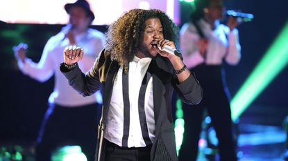 """Baltimore's Davon Fleming — photographed here performing on """"The Voice"""" last year —is forming a community youth choir in Baltimore."""