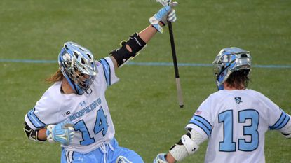 Attackmen Cole Williams (#14) and Kyle Marr (#13) have helped the Johns Hopkins men's lacrosse team rise to No. 5 in the media poll.