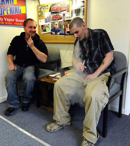 Brandon Smith and David Buechling talk and vape at Quality Vapor Source in Taneytown.