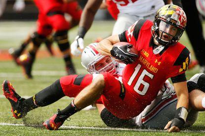 Ohio State defensive end Joey Bosa sacks Maryland quarterback C.J. Brown.