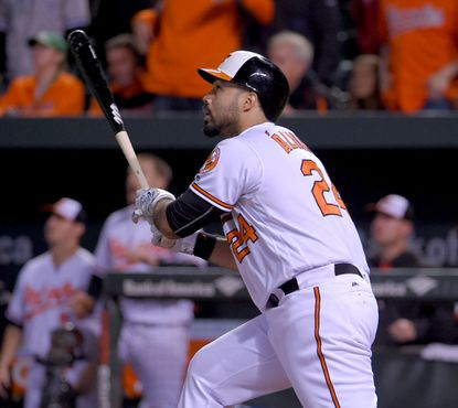 Orioles designated hitter Pedro Alvarez (24) drives the ball into the outfield for awalk-offsacrifice fly at Oriole Park at Camden Yards.The Oriolesclawed their way to edge the Yankees, 1-0, in 10innings on May 5, 2016.