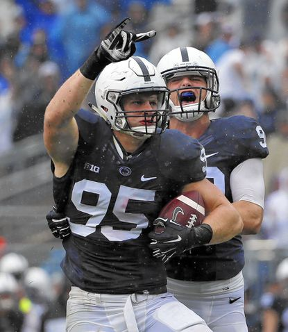 Penn State defensive end Carl Nassib (95) celebrates his second half interception with defensive end Garrett Sickels (90) during an NCAA college football game against Buffalo in State College, Pa., Saturday, Sept. 12, 2015. (AP Photo/Gene J. Puskar)