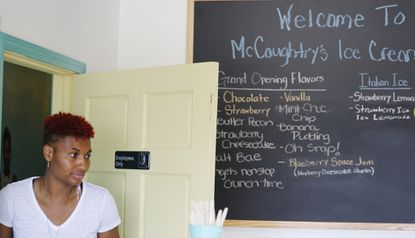 "Atlanta Dream player Angel McCoughtry (St. Frances) walks through her recently opened ice cream shop, ""McCoughtry's,"" located in Atlanta. She is sitting out the 2017 WNBA season to recover physically from playing year-round in the U.S. and overseas for eight years."
