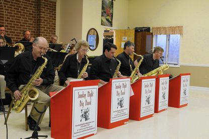 Players come together to perform as big band