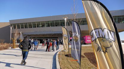 People race to the newly-opened UMBC Event Center, a 5,000-seat facility, next to the stadium.