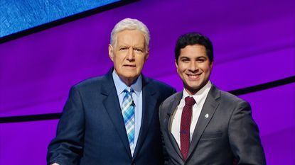 Sathvik Namburar, right, poses with Alex Trebek. Mr. Namburar appeared as a contestant on 'Jeopardy!' in August 2019.