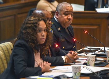 """Baltimore State's Attorney Marilyn Mosby, Mayor Bernard C. """"Jack"""" Young and Police Commissioner Michael Harrison testify Friday during a briefing on Baltimore crime in the joint hearing room in the Department of Legislative Services Building in Annapolis."""