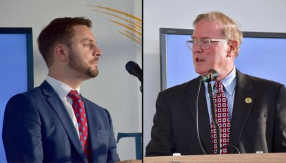 Democrat Robbie Leonard, left, a candidate for the District 42 state Senate seat, debates his opponent Republican Chris West on Sept. 28 at Towson University.