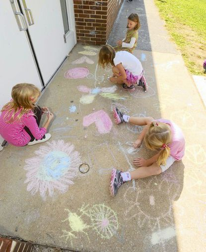 Girl Scout Daisy Troop 465 members Casey Hunter, top, Sophie Murray, white shirt, Jessie Kingsman, bottom right, and Sarah Sterner, left, draw signs and symbols peace signs, our planet earth as a flower and pink hearts to celebrate International Day of Peace at Pot Springs Elementary.