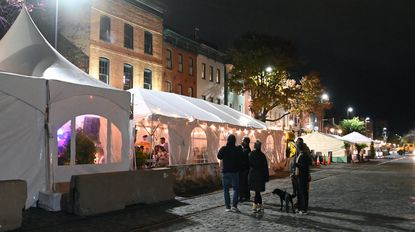 Tents are set up on Thames Street outside restaurants and bars in Fells Point to provide physical distancing during the coronavirus pandemic. October 31, 2020.