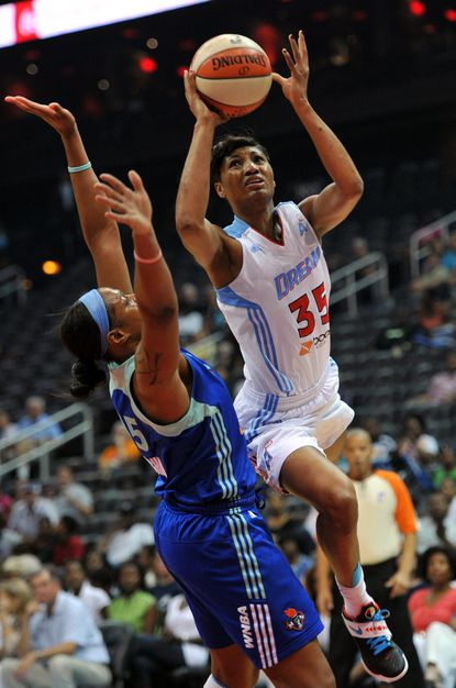 The Atlanta Dream's Angel McCoughtry drives to the basket against the New York Liberty.