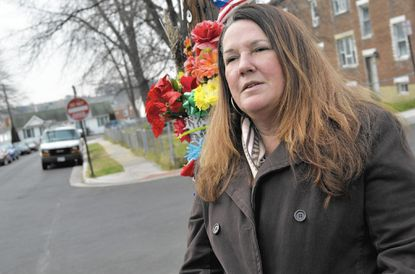 Trina Peterson, mother of robert nelson, stands near where her son was shot