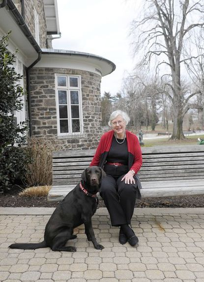 Jean Waller Brune, head of school at Roland Park Country School, will speak at two national conventions in Febrary 2014 about the school's plans to pen a public charter school in 2015. Brune is seen here on campus with her dog, Penny, in March.