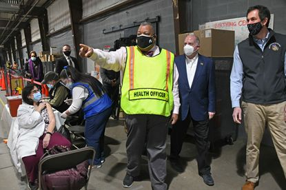 Baltimore County Health Officer Dr. Gregory Wm. Branch leads a tour of the Baltimore County's Timonium COVID-19 vaccine site for Governor Larry Hogan and Baltimore County Executive Johnny Olszewski.