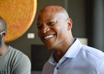 Wes Moore talks with friends at coffee shop in Pigtown after announcing he's running for Governor of Maryland. June 7, 2021