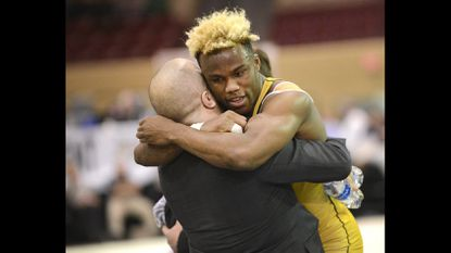 South Carroll's Jamar Williams celebrates his win with coach Bryan Hamper over Perryville's Eugene Zacerous during their 170-pound Class 2A-1A final in the MPSSAA state wrestling tournament in Upper Marlboro Saturday, March 4, 2017.
