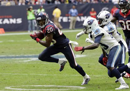 Houston Texans defensive back Jumal Rolle (20) returns an interception as Tennessee Titans' Kendall Wright (13) and Nate Washington (85) chase him during the second half of an NFL football game Sunday, Nov. 30, 2014, in Houston.
