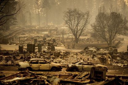 Homes leveled by the Camp Fire line a development on Edgewood Lane in Paradise, Calif., on Nov. 12, 2018. Pacific Gas and Electric says it has reached a $13.5 billion settlement that will resolve all major claims related to devastating wildfires blamed on its outdated equipment and negligence.
