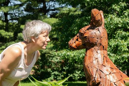 """Virginia Sperry is pictured with her sculpture titled """"Kangaroo."""""""