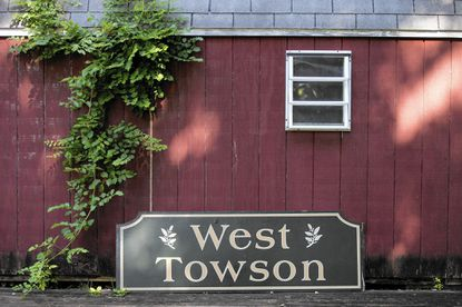 The long-lost West Towson community sign in Towson on Monday, July 20. It used to be at Chesapeake Avenue and Charles Street Avenue, until it was stolen after the 2012 Super Bowl. It turned up last week in a dumpster at Fairways at Towson apartments.
