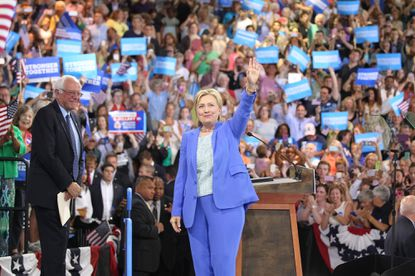 Hillary Clinton greets the crowd along with Sen. Bernie Sanders during an event where she was endorsed by Sanders at Portsmouth High School on Tuesday, July 12, 2016 in Portsmouth, N.H.