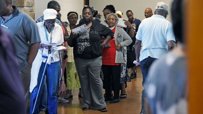 Voters wait in line to cast ballots during early voting at the Westside Skills Center in Edmondson Village. It's one of seven early voting centers in Baltimore.