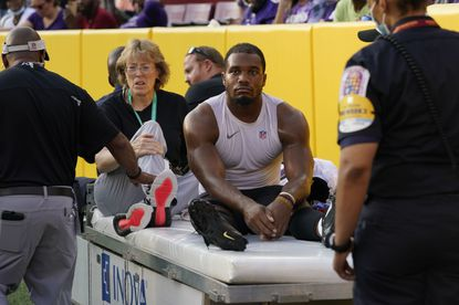 Baltimore Ravens running back J.K. Dobbins (27) is taken off the field after suffering a knee injury in the first half of a preseason game against the Washington Football Team, Saturday, Aug. 28, 2021, in Landover, Md. (AP Photo/Carolyn Kaster)