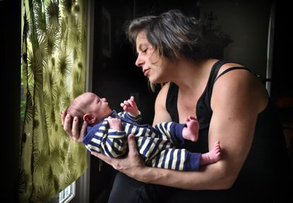 Patty Maizels, and eight-day old son, Reddick Timlin Maizels, who was delivered at home by father Patrick Maizels, with midwife Bayla Berkowitz and birth assistant Nikki Williams of Charm City Midwives in attendance.