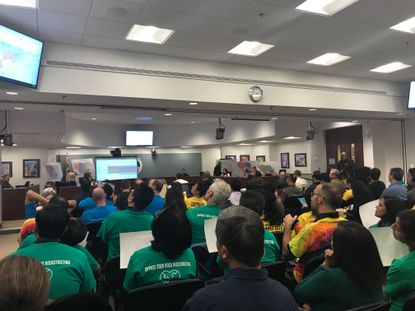 At Monday's second redistricting work session, the Howard County Board of Education discussed boundary lines for the 13th high school, to be built in Jessup, and began addressing high school capacity. Many community members were in attendance, holding signs and wearing T-shirts that represented different neighborhoods and groups.