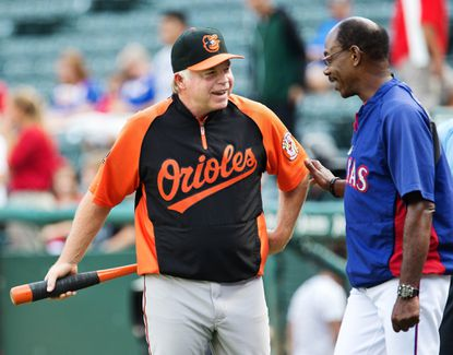 Orioles manager Buck Showalter laughs with Texas Rangers manager Ron Washington before Tuesday's game.