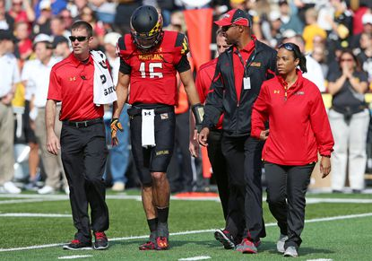 Maryland quarterback C.J. Brown leaves the field after suffering a back injury against Iowa at Byrd Stadium. He later returned to finish the game.