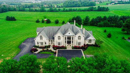 This Clarksville home features 7 bedrooms, 8 full bathrooms and 3 half bathrooms and 15,800 sq ft of living space on more than 3 acres.