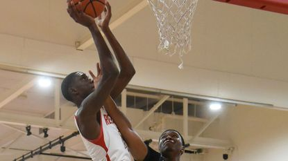 Edmondson's Tre'Shawn Lewis shoots over Lake Clifton's Zevon Hughes during the Red Storm's 73-67 win Feb. 7, 2019.