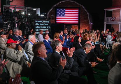 A mostly maskless crowd listens Wednesday as Vice President Mike Pence addresses the Republican National Convention from Fort McHenry in Baltimore.