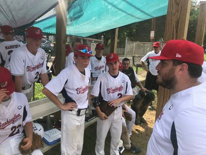 Hammond graduate Ben Miller, right, talks to his players as head coach of the 2019 Washington Pony League World Series team. The team will compete for a world championship in Washington, Pennsylvania, between Aug. 9-15.