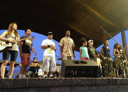 Competitors line the stage at the finale of the Laurel Youth Music Showcase From left are Christina Bartko, Jason McGill, Treyvon Lytle, Bryan White, Chantale Bonilla and Josh Fleming; winner NicKayla Tucker is flanked by two backup dancers at far right.