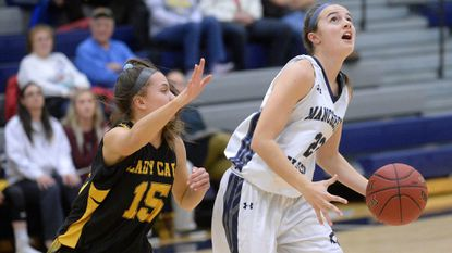Manchester Valley senior Mackenzie DeWees looks for a shot as South Carroll's Riley Evans defends in the first quarter of the Mavericks' win over the Cavaliers on Jan. 10, 2018.