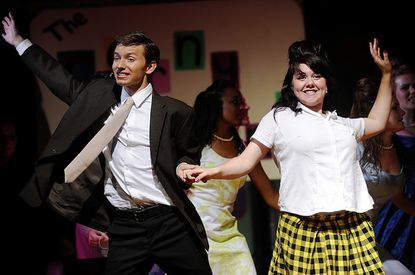 """Taylor Rieland and Rainelle Jochum dance onstage in a dress rehearsal of the TACTICC production of """"Hairspray"""" at Liberty High School in Eldersburg Tuesday, July 10, 2012."""