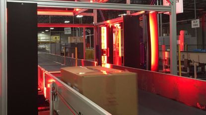 At FedEx's distribution center in Sparrows Point, packages are carried on a conveyor belt through a scanner that photographs all six sides in search of a destination address.