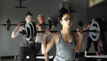 Rania Mohamed of Baltimore participates in a weightlifting class at Merritt's Canton location.