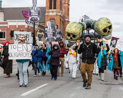 Protesters march down Hohman on their way to Federal Plaza in Hammond.