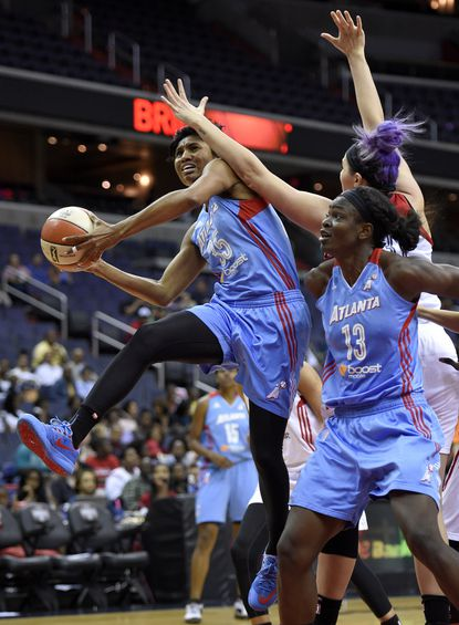 Atlanta's Angel McCoughtry goes to the basket against Washington's Stefanie Dolson during the first half.