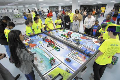 The Organized Kaos Team (First Lego League #5709) from Rockvilledemonstrate their robots at the opening of the STEM Education Center in Columbia on Friday.