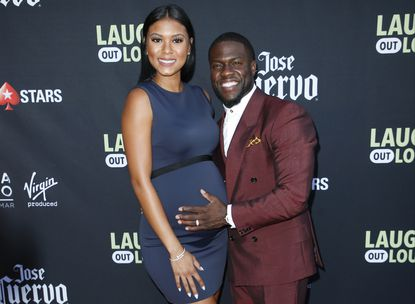 """Comedian Kevin Hart and his wife Eniko Parrish pose at Kevin Hart's """"Laugh Out Loud"""" new streaming video network launch event at the Goldstein Residence on in Beverly Hills, Calif."""
